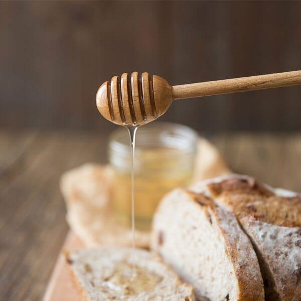 Long wooden honey dipper