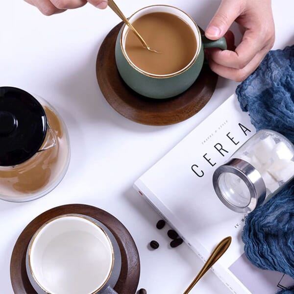 Ceramic cup with wooden tray